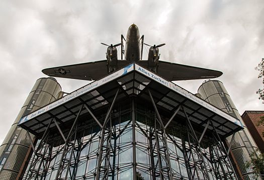 The German Museum of Technology in Berlin grabs attention in the urban space with a spectacular 'raisin bomber' installed on the building roof.