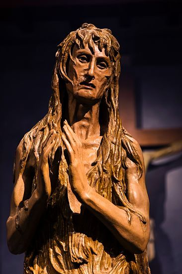 Illuminated sensitively and effectively, the poignant sculpture of Mary Magdalene is one of the most expressive of Donatello's works.